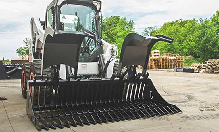 Skid Steer with Grapple Attachments
